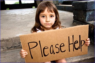 Child holding poverty sign