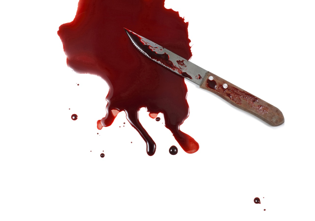 Knife in Puddle of Blood
